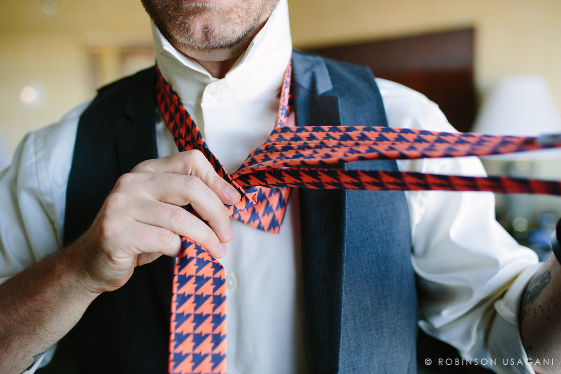 Groom putting the tie on