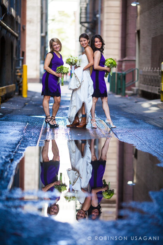 Bridal party posing in the alley